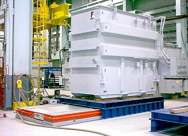 Huge transformers moved on air. Air casters provide a thin film of air under load for moving transformers on air.